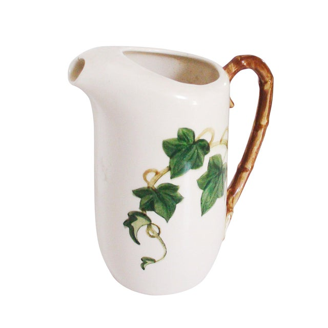 """Hand painted porcelain pitcher decorated with ivy and featuring a handle rendered as bamboo (9""""Dia x 10""""H). No Maker's Mark."""