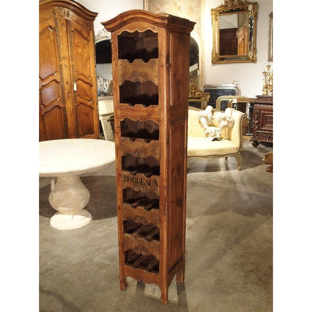 This wonderful tall and narrow French wine bottle carrier has the capacity to hold 14 bottles of wine. The cabinetmaker...