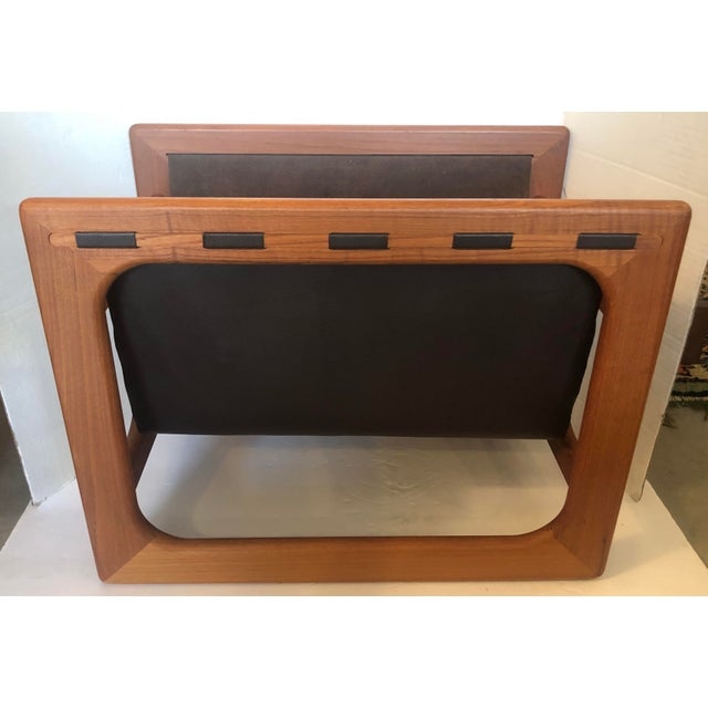 Timeless and cool large magazine rack by Salin Mobler. Iconic Danish design. Teak and leather. Excellent condition.