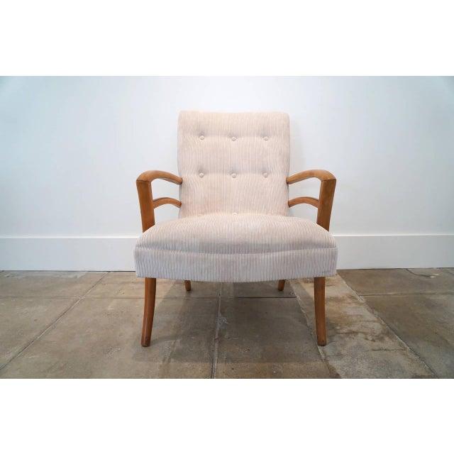 Sabre leg armchair newly upholstered in a bone velvet corduroy.