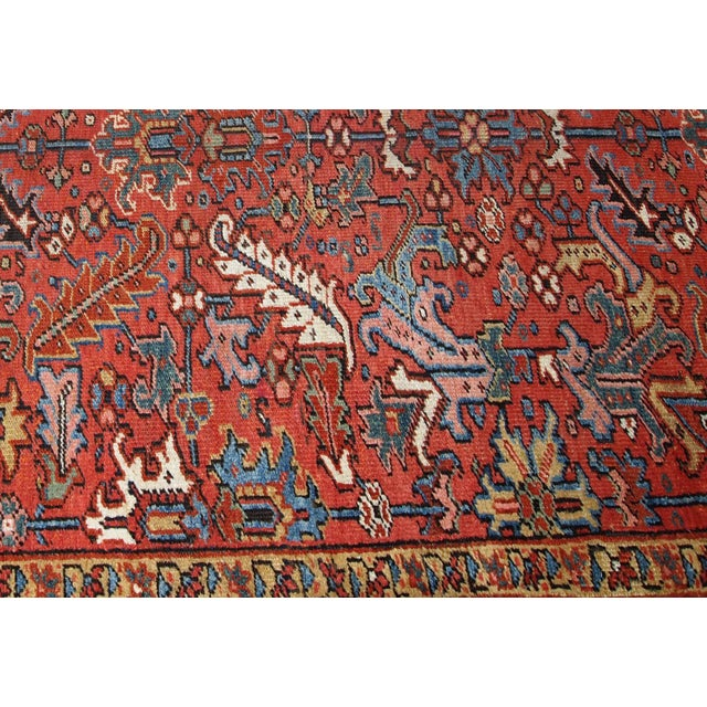 Hand made antique Heriz rug in red and black wool. The rug is from the beginning of 20th century in original good condition.