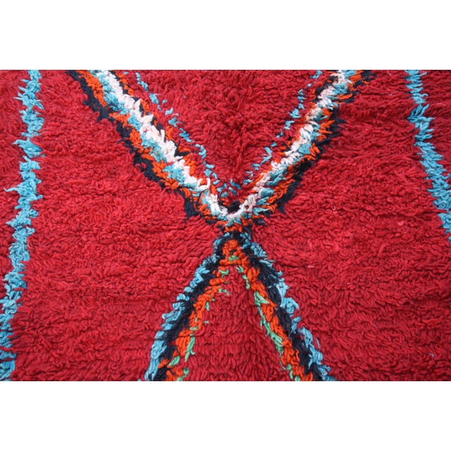 Hand-knotted Moroccan rug in soft organic wool featuring an ornate harlequin pattern. All around borders in sea green...