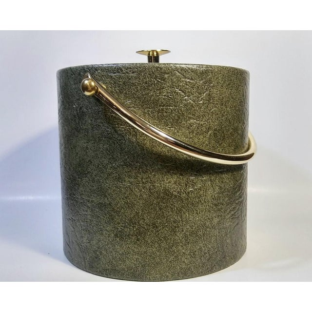 . Vintage ice bucket . Mid Century 1960s . Made by Henry & Miller Creations . Green faux leather with gold lid and handle...