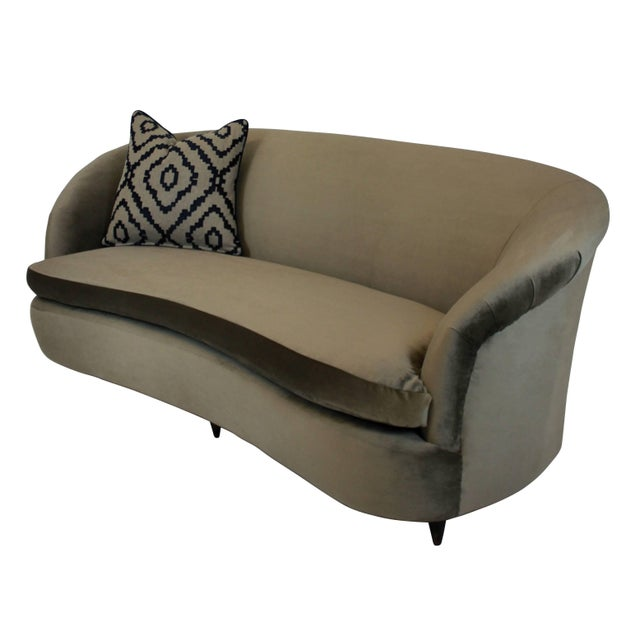 A large three-seat, extremely comfortable sculptural settee by Parisi, with swab cushion and newly upholstered in mole...