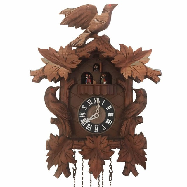 A vintage cuckoo clock. Germany, circa 1950. Designed to hang on wall. Dimensions: 13 inches L x 8 inches D x 18 inches H.