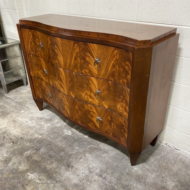 Stunning book matched mahogany 3 drawer chest with brass star pulls by Milling Road for Baker Fine Furniture. This piece...