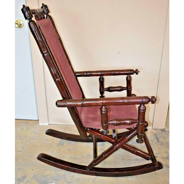Brown Vintage Faux Bamboo Rocking Chair With Mahogany Finish and Maroon Upholstery For Sale - Image 8 of 10