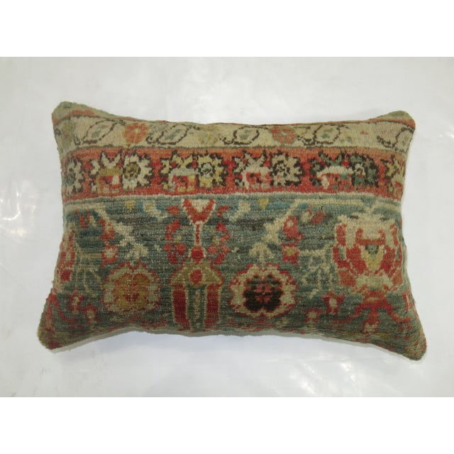 Pillow made from a 19th-century antique oushak rug with green cotton back. Zipper closure and foam insert provided. 15'' x...