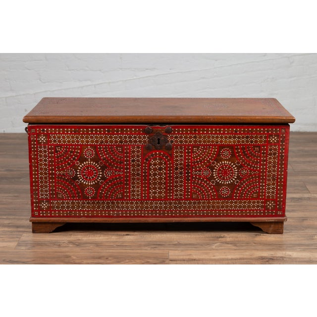 An antique 19th century Indonesian blanket chest from Madura, with red and brown accents and mother-of-pearl inlay. Born...