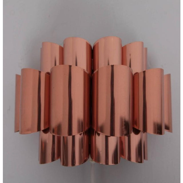 Beautiful pair of sconces or wall lights from the 1960s by Verner Schou. The scones have the form of wabes and the...