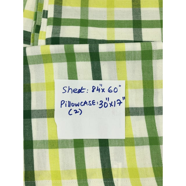 Quintessential Madras checks, inspired by the 70s fashion of multicolor checks on handloom fabrics. This summery cotton...