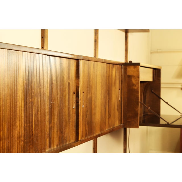Noral Olson for Kopenhavn wall-mounted walnut shelf unit. No shortage of storage with this setup! Pieces included are...