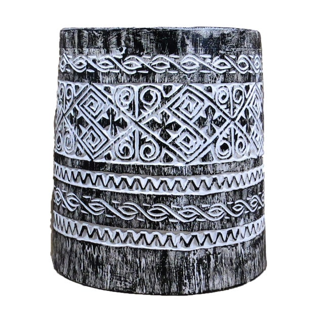 The side and top of this drum stool is hand carved with traditional Balinese decorative arts.This indigenous wood accent...