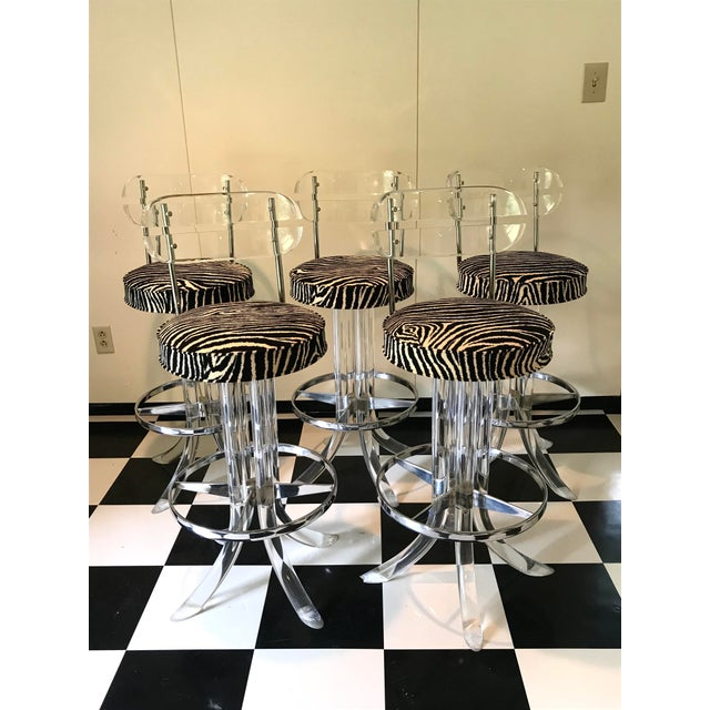 This is a truly unique and glamorously chic set of 5 barstools that are in amazing condition! Artfully made of lucite and...