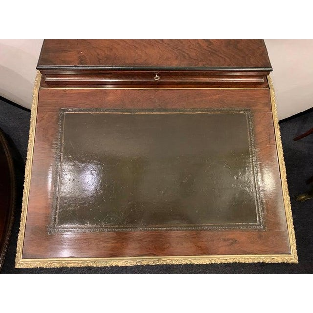 19th century Empire bronze mounted antique davenport desk. This desk has been fully refinished and can sit in the center...