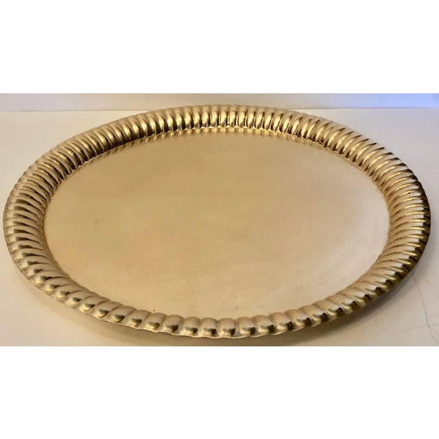 A beautiful solid brass tray made in India. India 9 49 is stamped on the back.