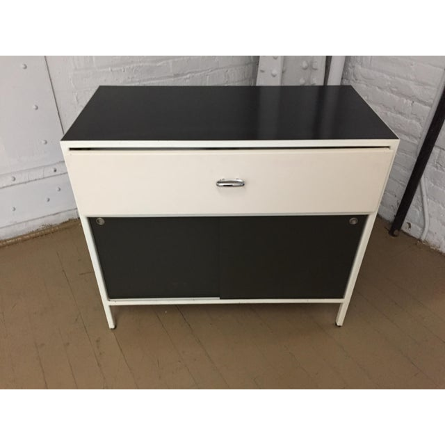 from our childhood bedroom! steelcase quality; sliding doors , steel frame, black laquer top, white pull out drawer,...