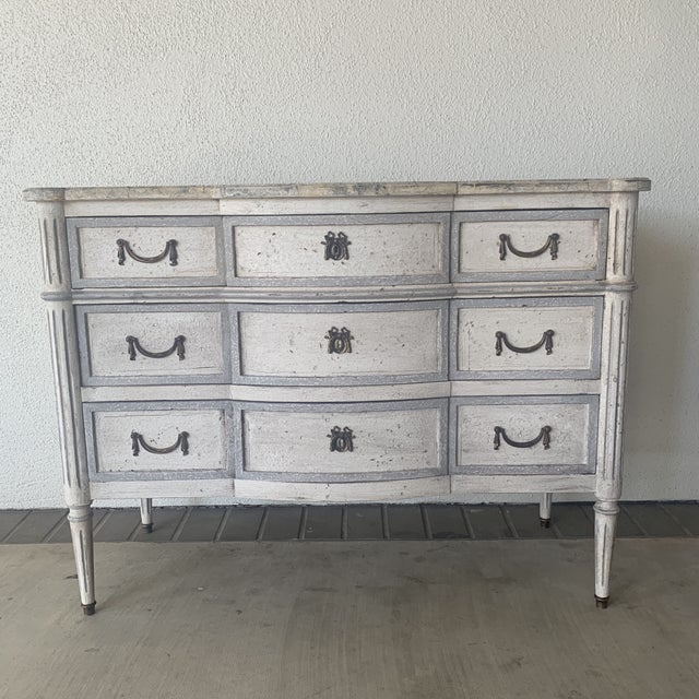 Beautiful antique French painted commode. With bow handles.