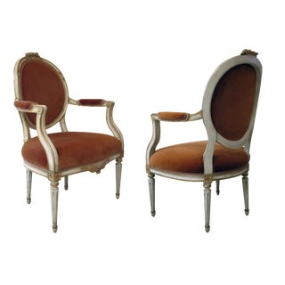 A Pair of Gustavian Style Ivory Painted & Parcel Gilt Armchairs For Sale