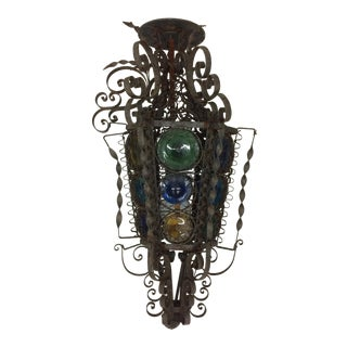Mediterranean Style Iron Light Fixture With Curly Cues and Colored Glass For Sale
