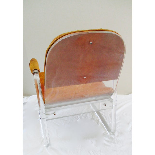 Amazing custom designed lucite and leather chair. This Lucite and Leather chair exudes refined sophistication and displays...