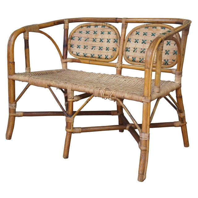 A gorgeous childrens love seat or settee. Made from bamboo with bentwood arms, barrel back and rattan seat.
