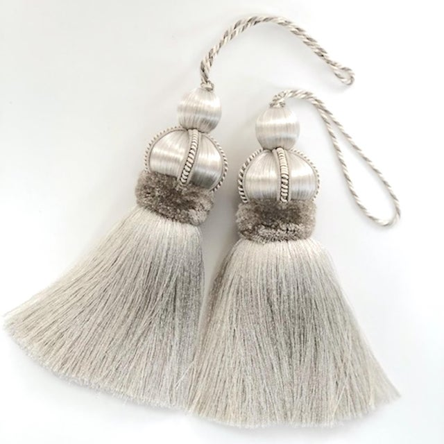 Pair of silver/gray colored key tassels with hand cut velvet ruche, decorative gimp and twisted cord detail. **Please...