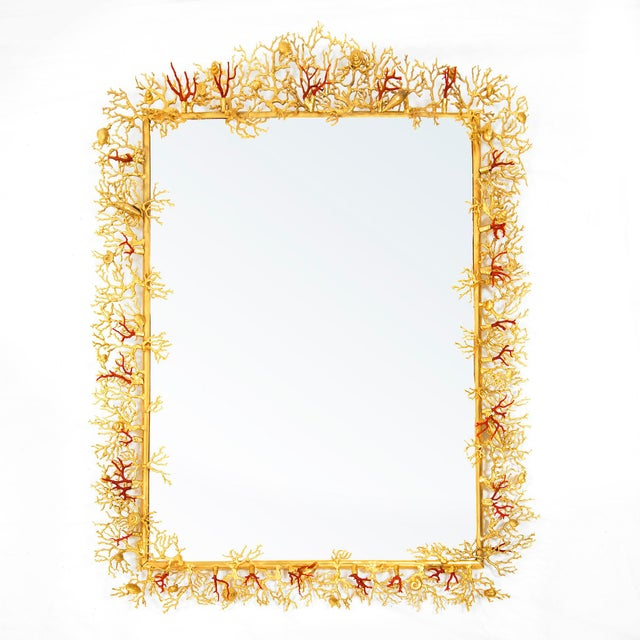 This mirror is a unique piece created by Robert Goossens (1927-2016) In gilt bronze and coral With small shells details...