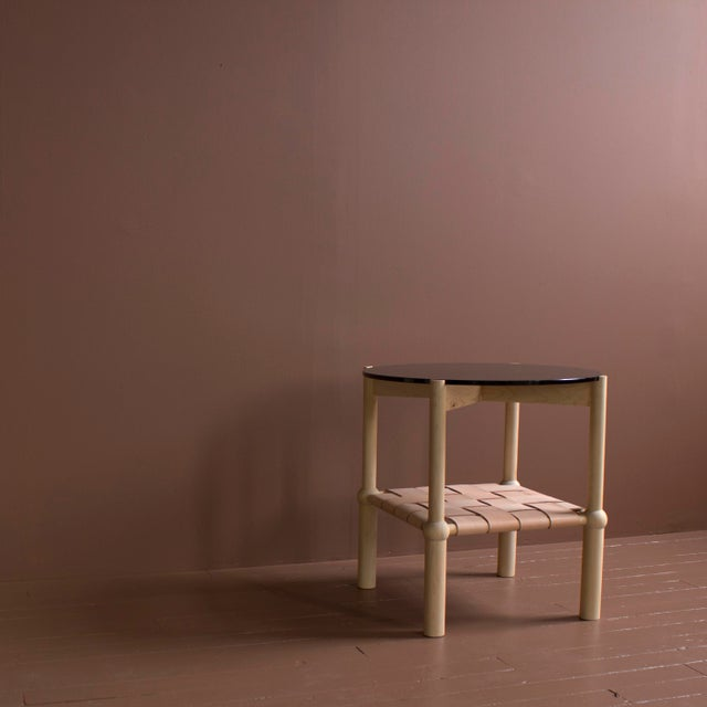 Solid wood frame / hand turned legs / zero voc oil finish / woven veg tanned leather / 1/2 in circular glass top...