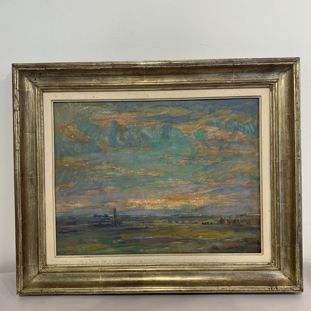 Vintage landscape appears to be a farm scene. Warm tones with silver frame.