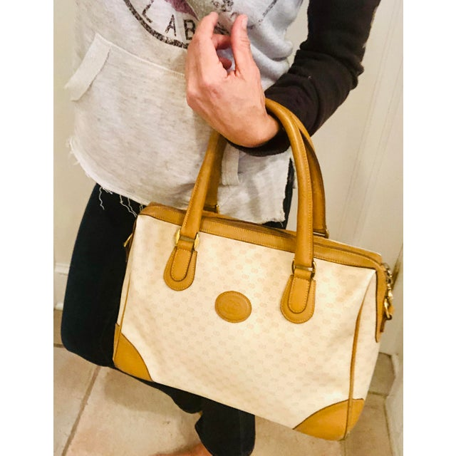 Iconic 1980s canvas GG logo satchel with tan leather trim and logo brass hardware. Immaculate interior. Due to the unique...