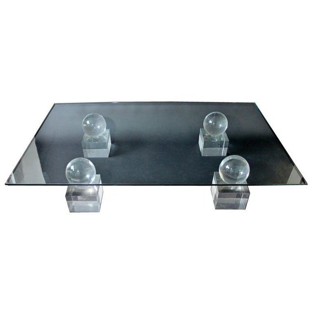For your consideration is an incredibly lux, large, rectangular coffee table, made of glass and with Lucite bases, by Karl...