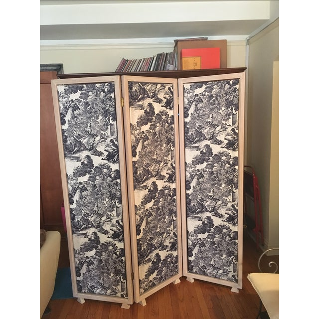 This custom made folding screen is solid wood with a white/black toile pattered fabric. It is in great condition. Has been...