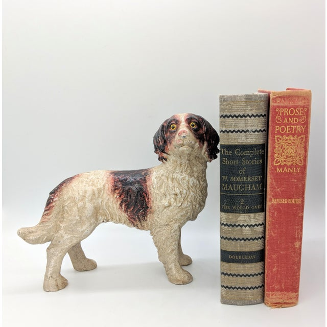 Adorable spaniel doorstop. Big puppy dog eyes highlight the features of the face. Perfect addition to vintage decor or for...