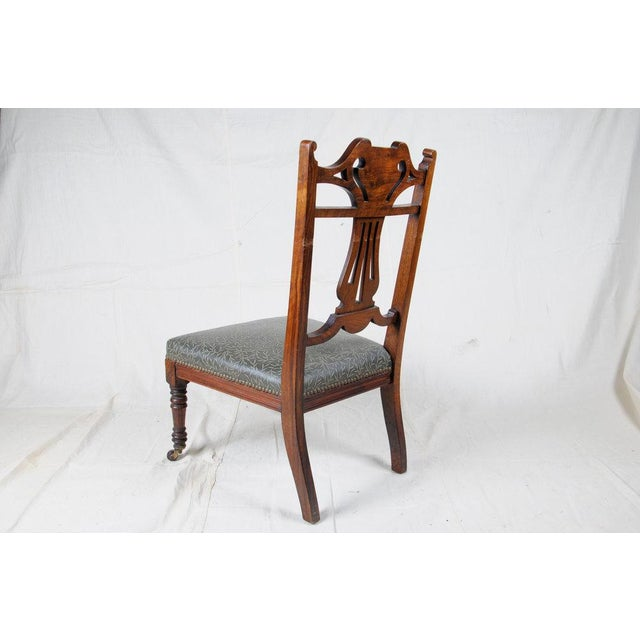 This 19th Century Slipper Chair has an embossed Edelman Leather seat finished with decorative brass upholstery tacks, and...