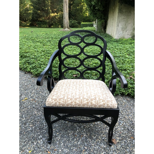 This is a rare set of twelve iconic Francis Elkins Loop chairs in a black satin matte lacquer. The looped backs sit atop...