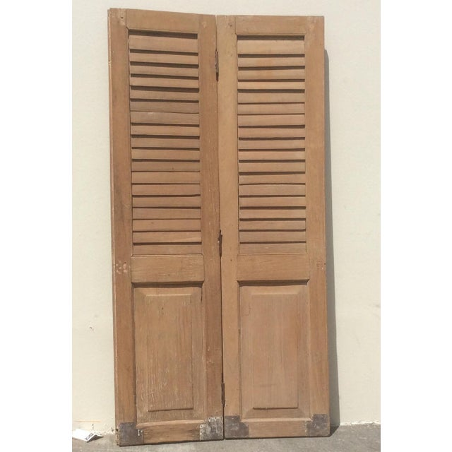 Single pair of heavy wood shutters with lots of character