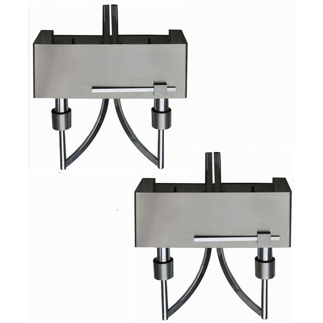 Pair of Italian, circa 1970 brushed and polished steel Two bulbs. Max wattage 60 W each. Wired for US and in working...