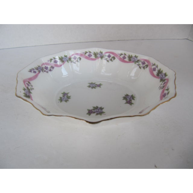 Small Mann dish with flowers and ribbon. Marked on the reverse, Mann Fine Bone China MCMLXXX.