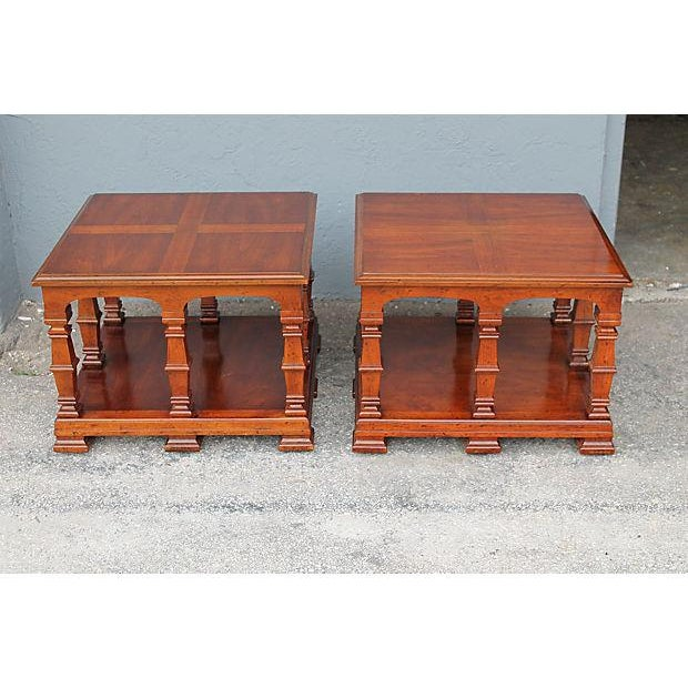 A pair of mid century modern mediterranean style end tables. Cross design on top of tables. This pair can be placed side...