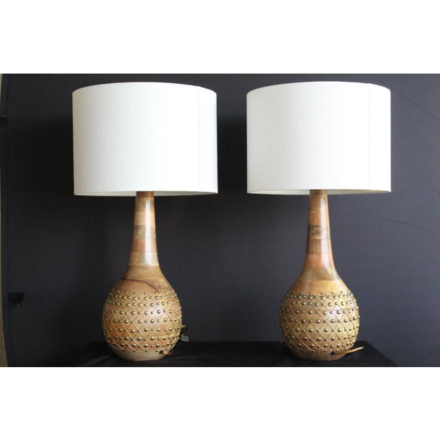 Unusual pair of pecan turned table lamps.Moroccan in feel. Hobnail brass design. Works with Mid Century Modern....