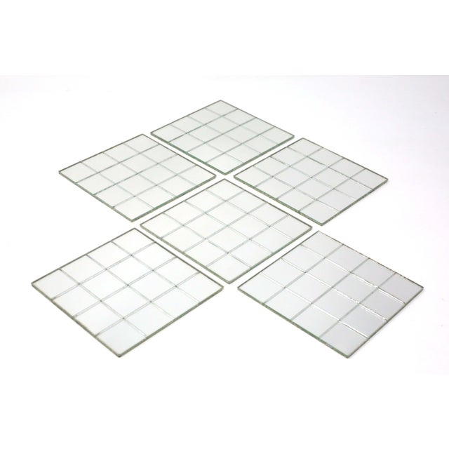 """A set of six vintage 4"""" x 4"""" beverage coasters, made of glass mirror tiles on flexible slip-resistant backing. Good..."""