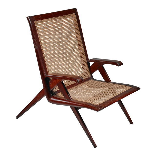 Brazilian walnut armchair with woven cane seating For Sale