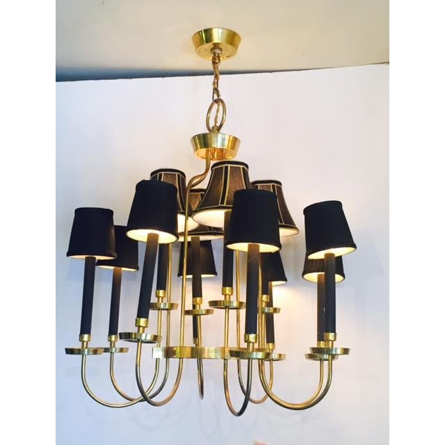 Stunning elegant Italian brass and black 12 light chandelier with a modern loft mid century look in great condition....