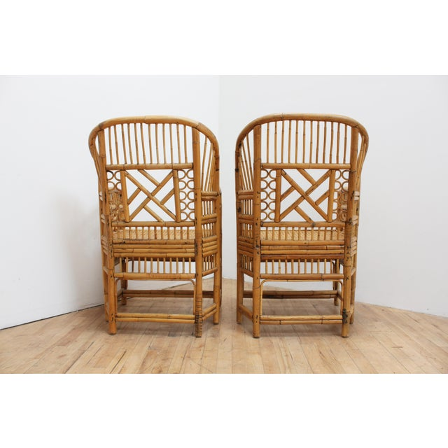 Matching pair of vintage Brighton Pavilion chairs- also known as Chinese or bamboo Chippendale chairs. Made from bamboo,...