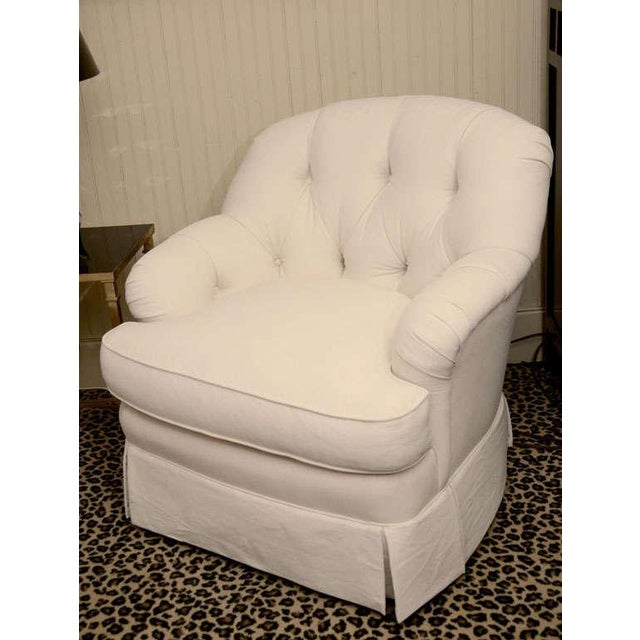 Sink into comfort with this tufted swivel club chair, made in England. Swivels 360 degrees. Ottoman is available...