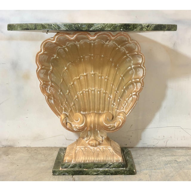 Cast plaster shell console table with wooden base and top attributed to Grosfeld House. The finish does not appear to be...