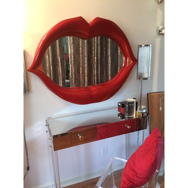 Harden acrylic enameled 3-D sculptured lips wall mirror. Hand shaped finished edges. This lip decor would definitely add a...