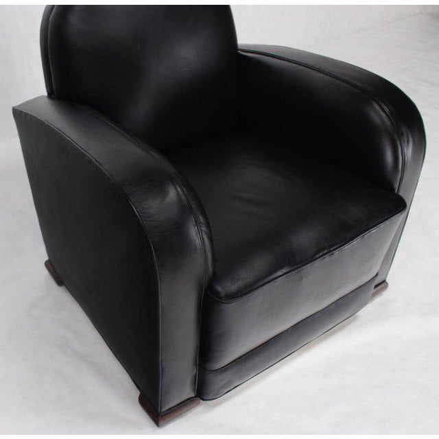 Pair of new black leather upholstery deco - mid century modern lounge chairs. Circa mid 20th century.