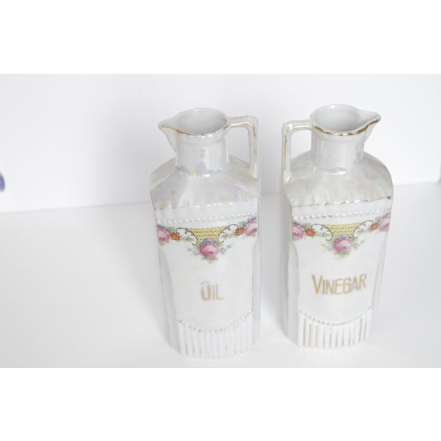 This colorful pair of German iridescent oil and vinegar condiment decanters from the turn of the century has a beautiful...